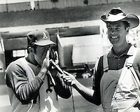 "Farmers Day at the Oakland Alameda County Coliseum Jim ""Catfish"" Hunter does a ""hog call"" for Monte Moore. (photo/Ron Riesterer)"