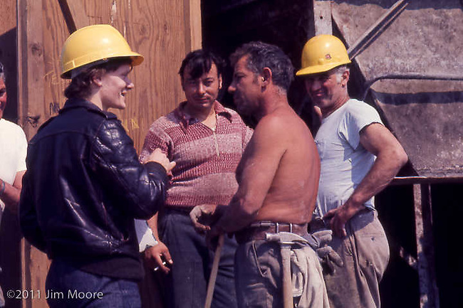 Philippe Petit talking with iron workers on top of South Tower of WTC