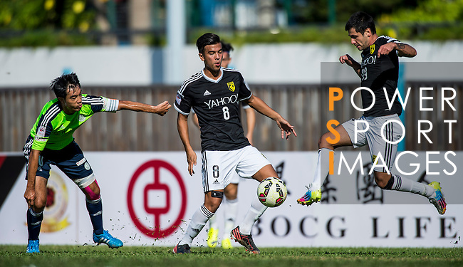 Aleksandar Randelovic of Sun Pegasus FC (R) competes for the ball with Chi Hing Lui of Wofoo Tai Po (L) during the HKFA Premier League between Wofoo Tai Po vs Sun Pegasus at the Tai Po Sports Ground on 22 November 2014 in Hong Kong, China. Photo by Aitor Alcalde / Power Sport Images