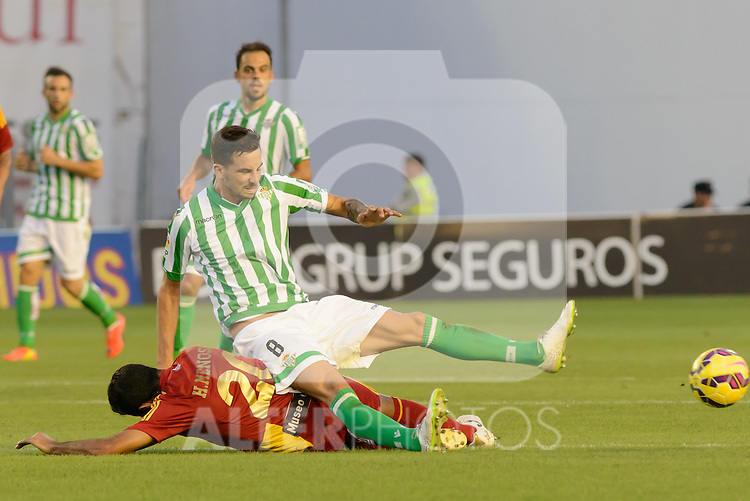 Menosse (L) and Renella (R) fall to the ground to dispute a ball during the match between Real Betis and Recreativo de Huelva day 10 of the spanish Adelante League 2014-2015 014-2015 played at the Benito Villamarin stadium of Seville. (PHOTO: CARLOS BOUZA / BOUZA PRESS / ALTER PHOTOS)