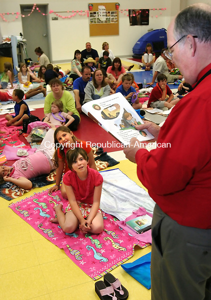 THOMASTON, CT 05/27/08- 052708BZ11- Allie Gilland, 9, back, and Kendyl Roman, 8, listen as principal Paul Johnson reads &quot;A Fine, Fine School&quot; by Sharon Creech, during a beach themed book event at Black Rock School in Thomaston Tuesday night.<br />  Jamison C. Bazinet Republican-American