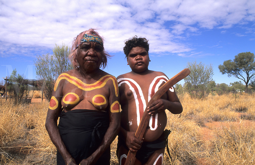 Near Alice Springs, Outback, Australia. Aboriginal people and their body artwork and bomberang for hunting.