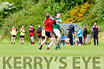 Jonathan Lyne  Legion is held up by Kenmare midfielder during their SFC clash in Killarney on Sunday