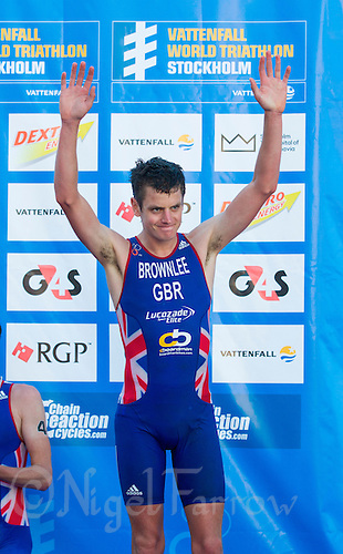 25 AUG 2013 - STOCKHOLM, SWE - Jonathan Brownlee (GBR) of Great Britain celebrates winning the bronze medal at the men's ITU 2013 World Triathlon Series round in Gamla Stan, Stockholm, Sweden (PHOTO COPYRIGHT © 2013 NIGEL FARROW, ALL RIGHTS RESERVED)