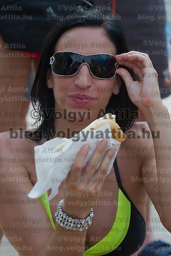 Marta Enyeri eats a hot dog during the Miss Bikini Hungary beauty contest held in Budapest, Hungary on August 06, 2011. ATTILA VOLGYI
