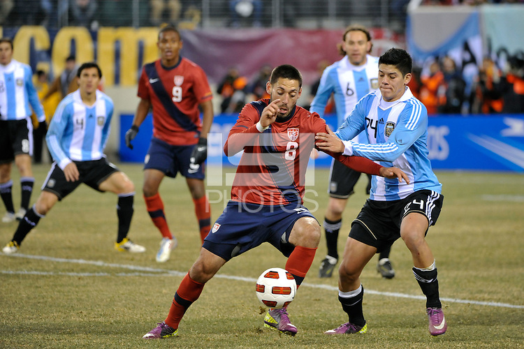 Clint Dempsey (8) of the United States under pressure from Marcos Rojo (24) of Argentina. The United States (USA) and Argentina (ARG) played to a 1-1 tie during an international friendly at the New Meadowlands Stadium in East Rutherford, NJ, on March 26, 2011.