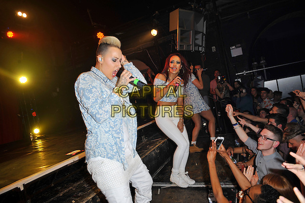 Courtney Rumbold, Karis Anderson  and Alexandra Buggs of Stooshe.Stooshe performing in concert, G-A-Y, Heaven Nightclub, London, England, UK, 11th May 2013..music concert gig live on stage performing girl band group full length  microphone singing.CAP/MAR.© Martin Harris/Capital Pictures.
