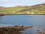 Croft houses along the shoreline at Leidag, Castlebay, Barra, Outer Hebrides, Scotland, UK