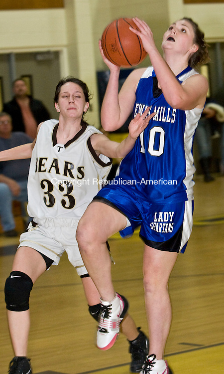 THOMASTON, CT - 22 JANUARY 2010 -012210JT04--<br /> Lewis Mills' Amanda Adamski approaches the basket while under pressure from Thomaston's Lizzie Eberhardt during Friday's game at Thomaston.<br /> Josalee Thrift Republican-American