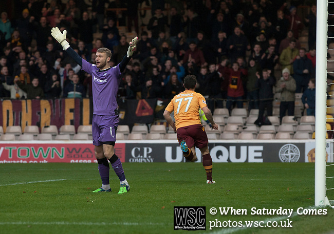 Motherwell 3 Dundee 1, 12/12/2015. Fir Park, Scottish Premiership. Home forward Scott McDonald turns away in celebration after giving his team into an early lead as Motherwell (in amber) play Dundee in a Scottish Premiership fixture at Fir Park. Formed in 1886, the  home side has played at Fir Park since 1895. Motherwell won the match by three goals to one, watched by a crowd of 3512 spectators. Photo by Colin McPherson.