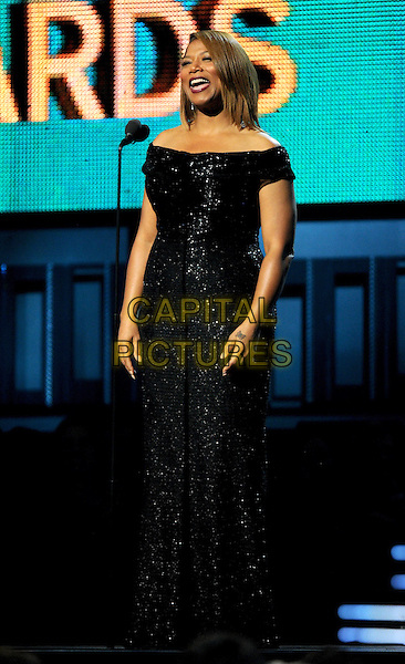 LOS ANGELES, CA - JANUARY 26 : Queen Latifah speaks onstage at The 56th Annual GRAMMY Awards at Staples Center on January 26, 2014 in Los Angeles, California.<br /> CAP/MPI/PG<br /> &copy;PGFMicelotta/MediaPunch/Capital Pictures