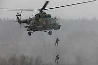 Krasnoarmeysk, Moscow Region, Russia, 29/10/2010..Russian special forces drop from a helicopter during training at a military base outside Moscow. The exercise was part of the Interpolitex 2010 state security exhibition.