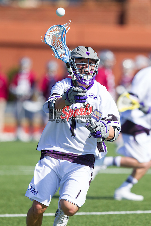 Joseph Taulane (1) of the High Point Panthers passes the ball against the St. Joseph's Hawks at Vert Track, Soccer & Lacrosse Stadium on February 16, 2014 in High Point, North Carolina.  The Panthers defeated the Hawks 9-7.   (Brian Westerholt/Sports On Film)