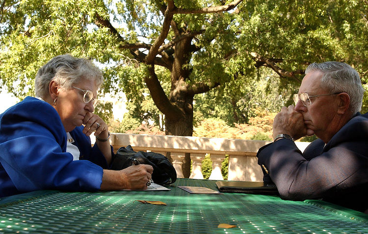 Pat and Bill Cerny of Bukre, SD, work on a crossword puzzle outside of Longworth, Thursday.  They were on the Hill to lobby for VFW issues.