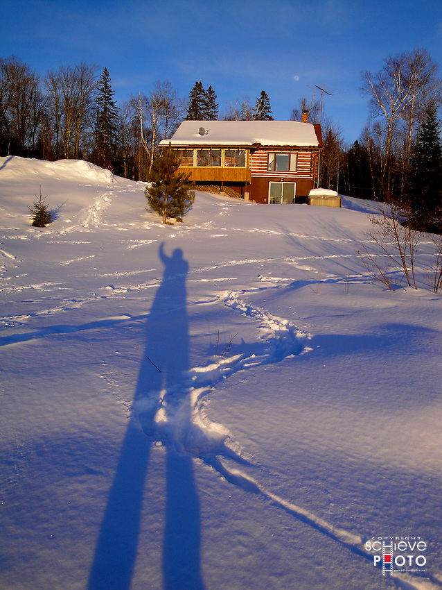 Casting a long winter shadow at the cabin on Spider Lake in northern Wisconsin.