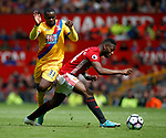 Jeffrey Schlupp of Crystal Palace in action with Timothy Fosu-Mensah of Manchester United during the English Premier League match at the Old Trafford Stadium, Manchester. Picture date: May 21st 2017. Pic credit should read: Simon Bellis/Sportimage