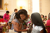 First Lady Michelle Obama greets guests during a Mother's Day Tea in the State Dining Room of the White House, May 7, 2010. .Mandatory Credit: Samantha Appleton - White House via CNP