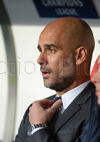 "13.04.2016. Lisbon, Portugal.  Munich's coach Josep ""Pep"" Guardiola sits on the bench prior to the UEFA Champions League quarterfinal second leg soccer match between SL Benfica and FC Bayern Munich at Luz Stadium in Lisbon, Portugal, 13 April 2016."