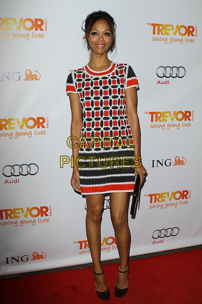 Zoe Saldana.Trevor Live at The Hollywood Palladium in Hollywood, California, USA..December 4th, 2011.full length dress clutch bag white black red print .CAP/ADM/KB.©Kevan Brooks/AdMedia/Capital Pictures.