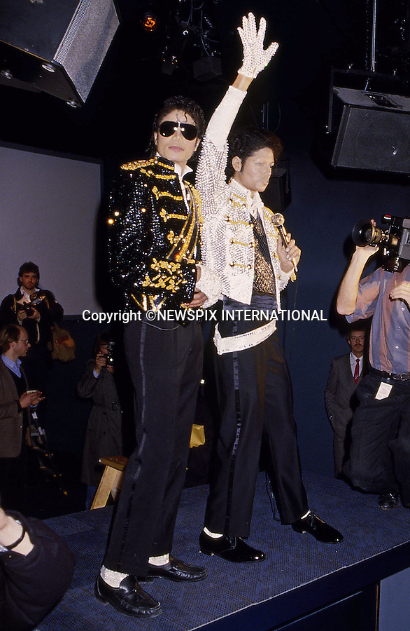 """MICHAEL JACKSON.Died today at UCLA Hospital Los Angles (25/06/2009) after suffering a heart attack and slipping into a coma at the age of 50...Michael Jackson at Madame Tussaud with his waxwork, London 1985.Mandatory Photo Credit: ©Francis Dias/Newspix International..**ALL FEES PAYABLE TO: """"NEWSPIX INTERNATIONAL""""**..PHOTO CREDIT MANDATORY!!: NEWSPIX INTERNATIONAL(Failure to credit will incur a surcharge of 100% of reproduction fees)..IMMEDIATE CONFIRMATION OF USAGE REQUIRED:.Newspix International, 31 Chinnery Hill, Bishop's Stortford, ENGLAND CM23 3PS.Tel:+441279 324672  ; Fax: +441279656877.Mobile:  0777568 1153.e-mail: info@newspixinternational.co.uk"""
