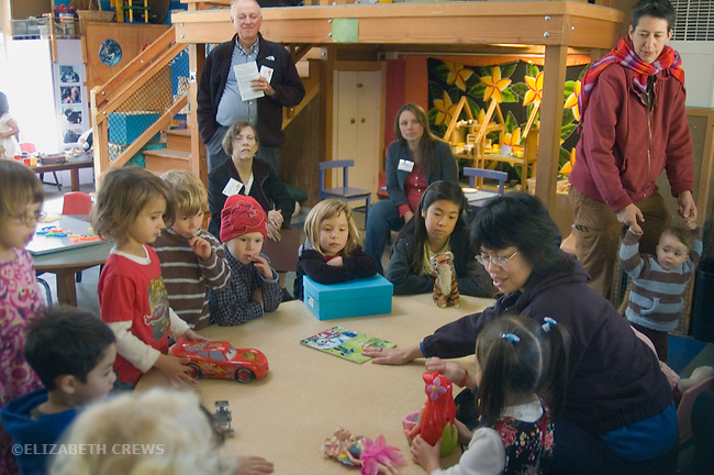 "Berkeley CA Four-year-olds at sharing time while parents and grandparents look on at preschool ""Grandparents' Day"""
