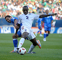 Cuba's Carlos Domingo Francisco plays the ball while being pressured by El Salvador's Arturo Alvarez.  El Salvador defeated Cuba 6-1 at the 2011 CONCACAF Gold Cup at Soldier Field in Chicago, IL on June 12, 2011.