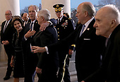 WASHINGTON, DC - DECEMBER 03: Former U.S. President George W. Bush puts his arm around former White House Chief of Staff Andy Card as he and members of his family follow the casket carrying Bush's father, former U.S. President George H. W. Bush, into the U.S. Capitol December 3, 2018 in Washington, DC. A state funeral for former U.S. President Bush will be held in Washington over the next three days, beginning with him lying in state in the Rotunda of the Capitol until Wednesday morning.(Photo by Win McNamee/Getty Images)