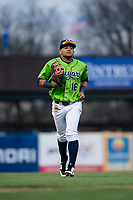 Kane County Cougars left fielder Jorge Perez (16) jogs off the field between innings of a Midwest League game against the Cedar Rapids Kernels at Northwestern Medicine Field on April 28, 2019 in Geneva, Illinois. Cedar Rapids defeated Kane County 3-2 in game two of a doubleheader. (Zachary Lucy/Four Seam Images)