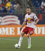 New York Red Bulls midfielder Eric Alexander (12) looks to pass. In a Major League Soccer (MLS) match, the New England Revolution (blue) tied New York Red Bulls (white), 1-1, at Gillette Stadium on May 11, 2013.