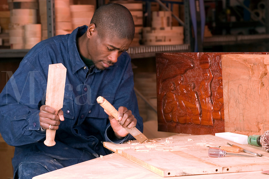 Young African American wood carving craftsman, Vermont