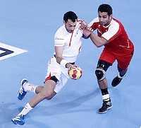 Egypt's Islam Hassan (r) and Spain's Daniel Sarmiento Melian during 23rd Men's Handball World Championship preliminary round match.January 14,2013. (ALTERPHOTOS/Acero) /NortePhoto
