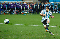 Lionel Messi of Argentina scores a penalty