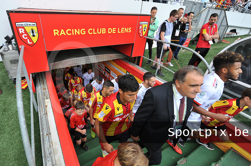 20190803 - LENS , FRANCE : illustration picture shows players entering the pitch pictured during the soccer match between Racing Club de LENS and En Avant Guingamp , on the second matchday in the French Dominos pizza Ligue 2 at the Stade Bollaert Delelis stadium , Lens . Saturday 3 th August 2019 . PHOTO DIRK VUYLSTEKE | SPORTPIX.BE
