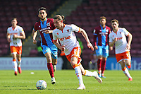 Blackpool's Antony Evans pushes forwards past Scunthorpe United's Levi Sutton<br /> <br /> Photographer David Shipman/CameraSport<br /> <br /> The EFL Sky Bet League One - Scunthorpe United v Blackpool - Friday 19th April 2019 - Glanford Park - Scunthorpe<br /> <br /> World Copyright © 2019 CameraSport. All rights reserved. 43 Linden Ave. Countesthorpe. Leicester. England. LE8 5PG - Tel: +44 (0) 116 277 4147 - admin@camerasport.com - www.camerasport.com