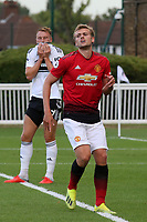 James Wilson of Manchester United U23's was suffering with an injury in the latter stages of the first half and was subsequently replaced at half-time during Fulham Under-23 vs Manchester United Under-23, Premier League 2 Football at Motspur Park on 10th August 2018