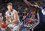 SIOUX FALLS, SD - MARCH 5:  Keaton Moffatt #12 of South Dakota State looks to pass past Albert Owens #44 of Oral Roberts in the 2016 Summit League Tournament. (Photo by Dick Carlson/Inertia)