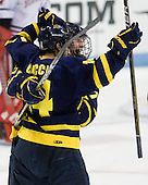 Joe Cucci (Merrimack - 14) and Karl Stollery (Merrimack - 7) celebrate Cucci's second of three goals. - The visiting Merrimack College Warriors defeated the Northeastern University Huskies 4-3 (OT) on Friday, February 4, 2011, at Matthews Arena in Boston, Massachusetts.