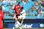 15 July 2015: Maykel Alejandro Reyes (CUB) (9) heads over Brandon De Leon (GUA) (17). The Cuba Men's National Team played the Guatemala Men's National Team at Bank of America Stadium in Charlotte, NC in a 2015 CONCACAF Gold Cup Group C match. Cuba won the game 1-0 and advanced to the quarterfinals.