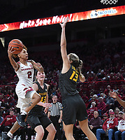 Arkansas' Alexis Tolefree takes a shot while Missouri's Hannah Schuchts (13) defends Sunday Jan. 12, 2020 at Bud Walton Arena in Fayetteville. The Hogs won 90-73.  <br /> Visit http://bit.ly/35LCcWr for a gallery of the game. (NWA Democrat-Gazette/J.T. Wampler)