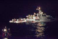 Die Sea Watch-2 Crew war am Freitag den 21. Oktober 2016 in den fruehen Morgenstunden waehrend ihrer 13. SAR-Mission vor der libyschen Kueste zu einer Position ausserhalb der 12 Meilenzone gerufen worden. Es war ein Fluechtlingsschlauchboot gesichtet worden. Als die Sea Watch-2 dort eintraf sah sie ca. 150 Menschen zusammengepfercht in einem ueberfuellten Schlauchboot sitzen. Eine Versorgung der Menschen auf dem Fluechtlingsschlauchboot mit Rettungswesten durch die Rettungs Boote der Sea Watch-2 wurde von der libyschen Kuestenwache unterbunden. Ein Soldat der Kuestenwache enterte das Schlauchboot vom Bug und machte sich dann an dem Aussenbordmotor zu schaffen. Auf dem Weg dahin schlug und trat er die Gefluechteten ein. Nach einigen Minuten entfernte sich das Boot der Kuestenwache. Dann verlor der Bug des Schlauchbootes seine Luft und es brach Panik bei den Gefluechteten aus. Sie sprangen in das Wasser und versuchten zum Schiff Sea Watch-2 zu gelangen. Die Crew warf ihnen Schwimmwesten und Rettungsringe zu, die Besatzungen der Rettungsboote der Sea Watch-2 zogen Menschen aus dem Meer, dennoch sind bis zu 30 Menschen ertrunken. Vier Ertrunkene konnten von der Sea Watch geborgen werden.<br /> 21.10.2016, Mediterranean Sea<br /> Copyright: Christian-Ditsch.de<br /> [Inhaltsveraendernde Manipulation des Fotos nur nach ausdruecklicher Genehmigung des Fotografen. Vereinbarungen ueber Abtretung von Persoenlichkeitsrechten/Model Release der abgebildeten Person/Personen liegen nicht vor. NO MODEL RELEASE! Nur fuer Redaktionelle Zwecke. Don't publish without copyright Christian-Ditsch.de, Veroeffentlichung nur mit Fotografennennung, sowie gegen Honorar, MwSt. und Beleg. Konto: I N G - D i B a, IBAN DE58500105175400192269, BIC INGDDEFFXXX, Kontakt: post@christian-ditsch.de<br /> Bei der Bearbeitung der Dateiinformationen darf die Urheberkennzeichnung in den EXIF- und  IPTC-Daten nicht entfernt werden, diese sind in digitalen Medien nach §95c UrhG rechtlich geschuetzt. Der Urheb