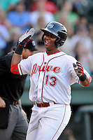 Designated hitter Rafael Devers (13) of the Greenville Drive crosses the plate with a run in a game against the Charleston RiverDogs on Sunday, May 24, 2015, at Fluor Field at the West End in Greenville, South Carolina. Devers is the No. 6 prospect of the Boston Red Sox, according to Baseball America. Charleston won 3-2. (Tom Priddy/Four Seam Images)