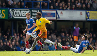 Gozie Ugwu of Wycombe Wanderers  leaves Gary Roberts of Portsmouth grounded during the Sky Bet League 2 match between Portsmouth and Wycombe Wanderers at Fratton Park, Portsmouth, England on 23 April 2016. Photo by Andy Rowland.