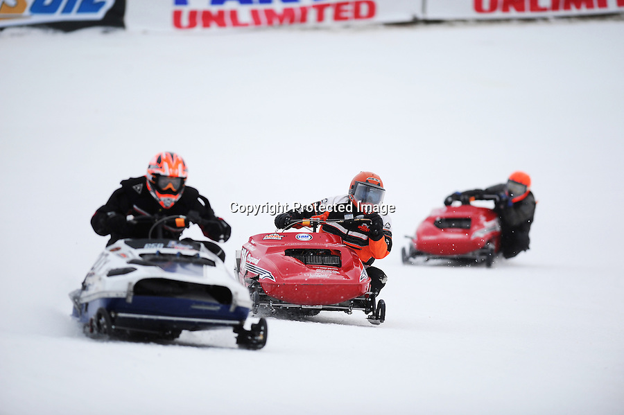 Classic vintage snowmobile race at Eagle River Snowmobile Derby, Sunday, Jan. 11, 2009. Tony Pettinelli, Jr., of York, NY, (center) looks for the inside shot ion Jacob Goede, of Shakopee, MN, in the Vintage World Championship Race. Pettinelli on a Chaparral Firebird SSX took the checkers after passing Goede, who was on a Polaris Starfire on the eighth lap of the 10 lap feature.