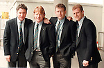 Ally McCoist, Stuart McCall, Andy Goram and Gordon Durie pose in their club suits at Glasgow Airport