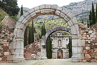 Entrance courtyard, 16th - 18th century, with Portal of the Virgin Mary, Baroque style, in the distance, Cartoixa d'Escaladei (Carthusian Monastery of Santa Maria d'Escaladei), 1194, Escaladei, at the foot of the Montsant range, Priorat, Tarragona, Spain. Cartoixa d'Escaladei was the first Carthusian monastery in the Iberian peninsula. Picture by Manuel Cohen