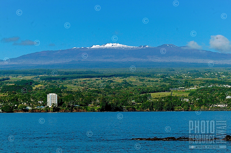 A majestic view of Mauna Kea above Hilo Bay, Big Island. Mauna Kea (or White Mountain) is the great protector of this beautiful and special place, Hilo. In Hawaiian mythology, the peaks of the island of Hawai'i are sacred, and Mauna Kea is one of the most sacred.