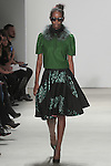 Brenda walks runway in an emerald merino wool sweatshirt with fern silver fox collar and flora jacquard circle skirt, from the Georgine Fall 2016 collection, by Georgine Rateland at NYFW: The Shows Fall 2016, during New York Fashion Week Fall 2016.