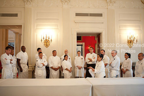 White House Executive Chef Cris Comerford, foreground, briefs staff on preparations for the State Dinner honoring Mexico, in the State Dining Room of the White House, Wednesday, May 19, 2010. .Mandatory Credit: Samantha Appleton - White House via CNP