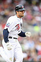 April 2, 2010: J.J. Hardy of the Minnesota Twins in the first professional baseball game played at the Twins new home, Target Field. Photo by: Chris Proctor/Four Seam Images