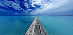 A seemingly infinite but rickety pier takes to the horizon and maybe across the entire ocean if you dare.